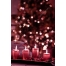 Christmas background with candles and bokeh lights