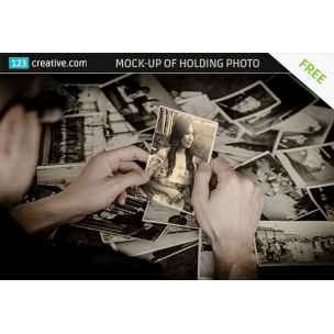 FREE Mock-up of a guy holding Old Photo